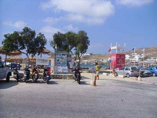 Deliades Hotel: Ornos beach bus stop (in front of man). taxi boat tickets from shed in front of motorbike