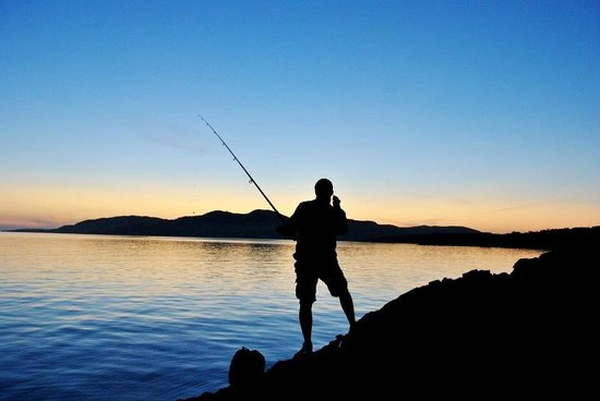 The Summer Isles Hotel and Restaurant: Fishing On The Beach
