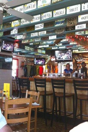 Tortugas lie shellfish bar license plates on walls