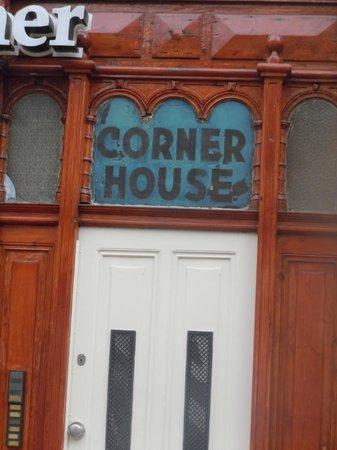 Hotel Cafe Corner House: Sign on side of hotel