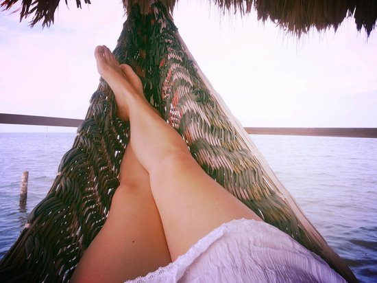 Barefoot Beach Belize: Relaxing in the hammock on private dock