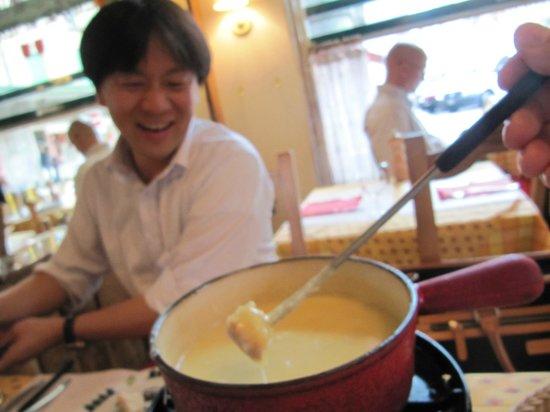 Auberge de Saviese: Fondue-ing with my Japanese colleague.
