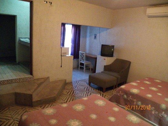 Hotel Posada San Martin: Habitación con dos camas dobles