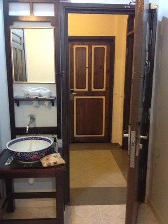 The Baba House: Bathroom sink, Front Door
