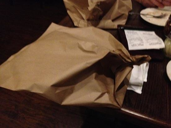 Bacco's: this is the way the wrap the leftover pizza, brown papaer bag. I've only seen this in the Waterb