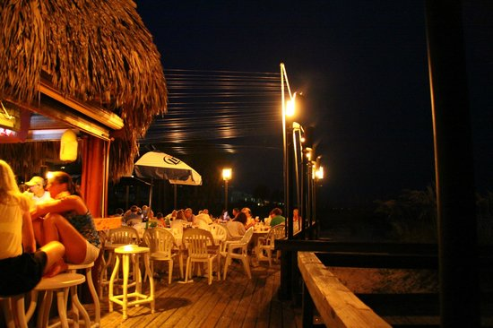 Blue Parrot: outside at the bar and deck on the beach