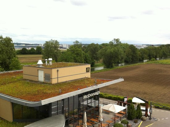 Park Inn by Radisson Zurich Airport: the view from my room. McDonalds, field, runway.