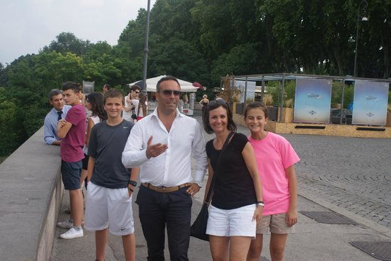 Private Tour in Italy by Domenico Iaccarino: Domenico with my wife and kids at a scenic overlook in Rome.