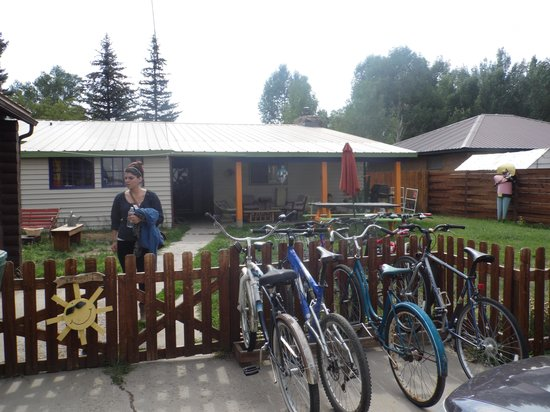 The Wanderlust Hostel: Back entrance, porch and bikes.extra parking
