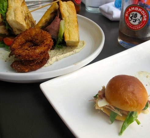 The Village House: Smoked meat sandwich with onion rings (left), Ceasar Sliders (right)