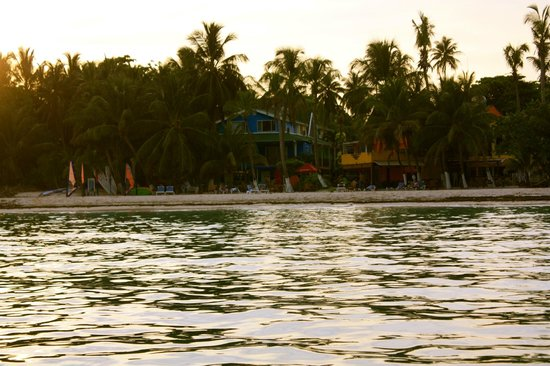 Cocoplum Beach Hotel: View of hotel from boat