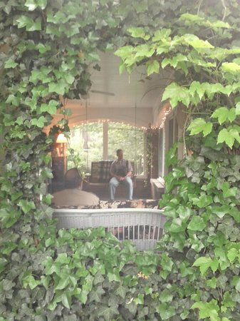 Ivy Inn: Looking through outside window into the sitting area on porch.