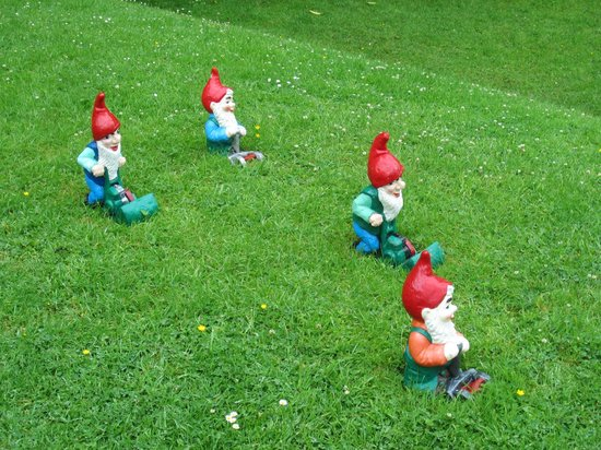 The Gnome Reserve & Wild Flower Garden: Even the gnomes do yard work.