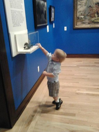 The Rockwell Museum: my son checking out an antique toy