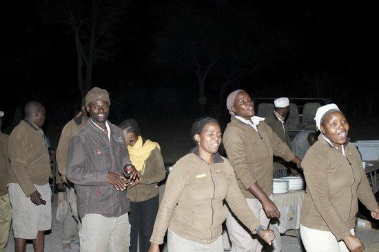 Wilderness Safaris Kings Pool Camp: Staff singing and dancing at the Braai