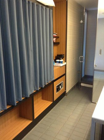 Aloft Chicago O'Hare: Minimal closet space behind curtain. Shower/WC separated from sink by sliding glass door.