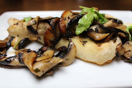 Oasis Bar and Restaurant: Mushroom Bruchetta, Sauteed mushrooms in garlic & tarragon butter on grilled ciabatta