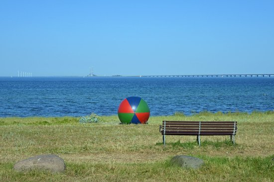 Nyborg Strand: View from the front of the hotel, with the storebaelt bridge (and some wind mills) in the backgr