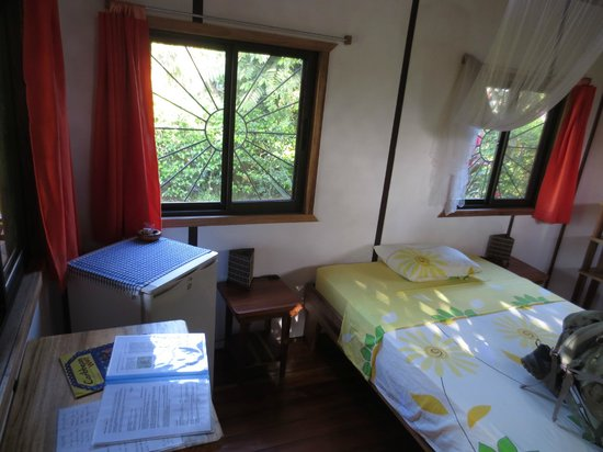 Cabinas Yamann: View out the screened window, and mini-fridge