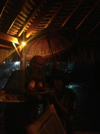 Warung Sasak: Mick & Harry ran across in the pouring rain to bring over our dinner