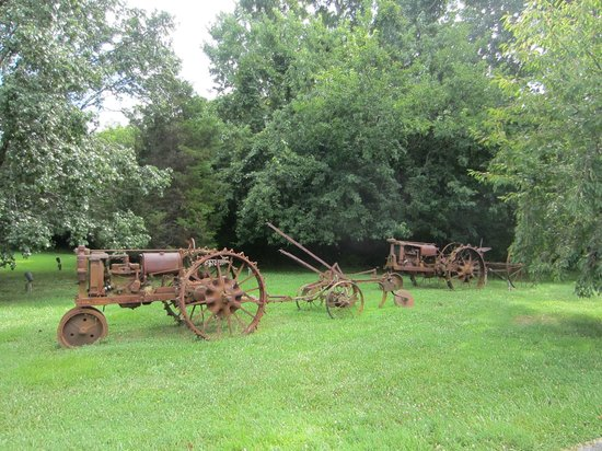 Waterfront Historic Kent Manor Inn : Antique farm equipment