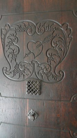 St. Thomas Church: sacred heart carving on door