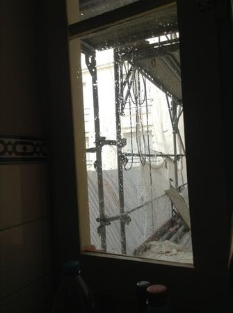 Special Apartments: water pours down kitchen window about 9am monday morning