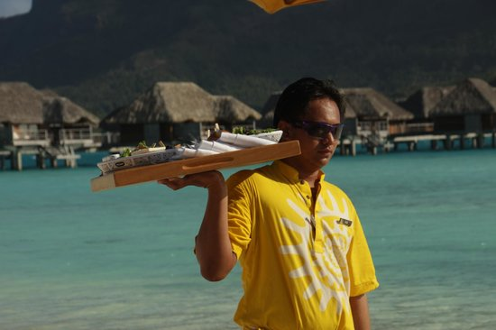 Four Seasons Resort Bora Bora: 4S Service everywhere, here on the beach - With Tahitian kindness and heart.