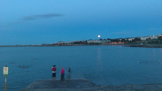 Seapoint Beach: Swimmers enjoy waters at Seapoint at 10 p.m. as full moon rises
