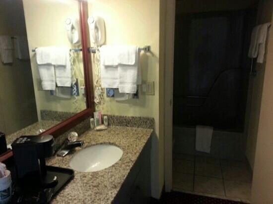 Quality Inn & Suites River Suites: vanity between living room and bedroom suite 300