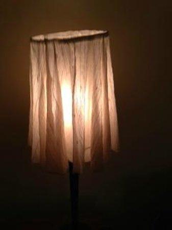 Hudson House Inn: limp paper shade on wobbly lamp