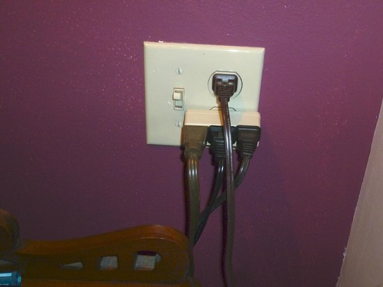 Delaware Hotel: Cord on the left is an extension cord with even more plugged in.