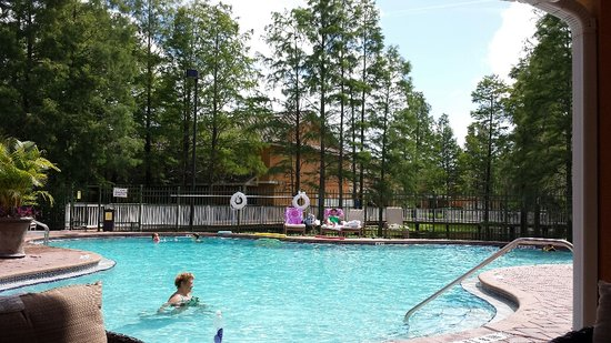 Best Western Premier Saratoga Resort Villas: beautiful pool area with water view and trees