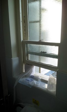 The White Rabbit: Old window requiring jamming open with toilet roll