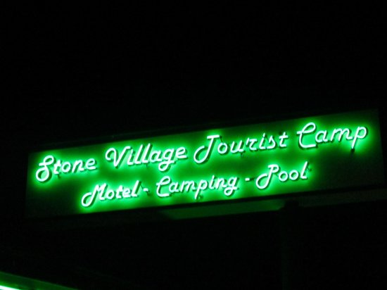 The Stone Village Tourist Camp: Green neon sign at night!