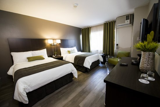 V Hotel and Suites: Renovated Deluxe Room With 2 Double Beds