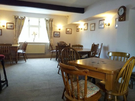Generous Briton : Dining tables in the bar area