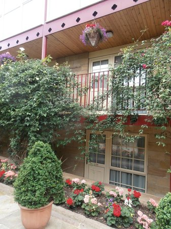 The Garrison Hotel: View of room 119 and room above with flowers