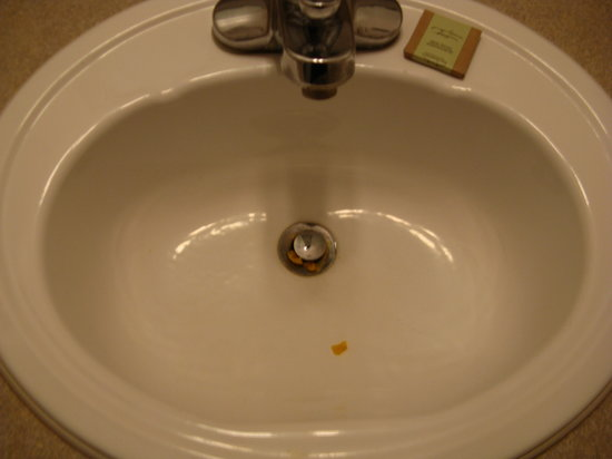 Super 8 Hinton: Junk in bathroom sink found at check-in