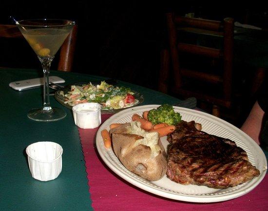 The Brownstone Inn: Rib Eye Steak - mid-rare, baked, mixed veg, salad with bleu