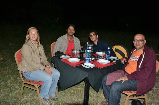 Mara Eden Safari Camp: Dining outdoor with camp owners