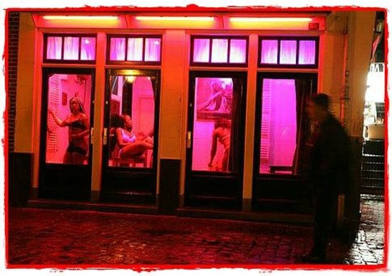 Everyday Walking Tours: See girls working behind windows to attract men in the Red Light District
