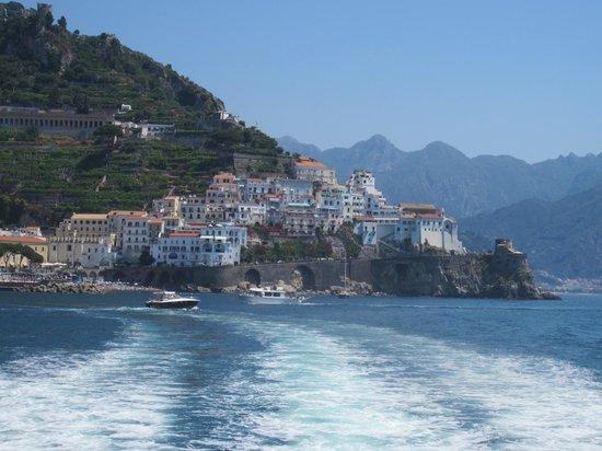 La Scogliera is atop the rocky point at the far right of the coast