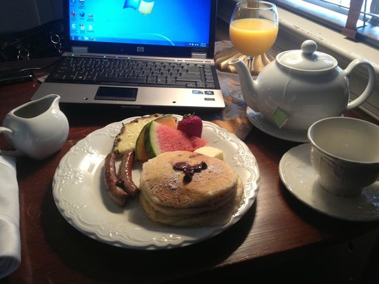 Stafford House: Chocolate Chip Pancakes, Sausage, and Fresh Fruit