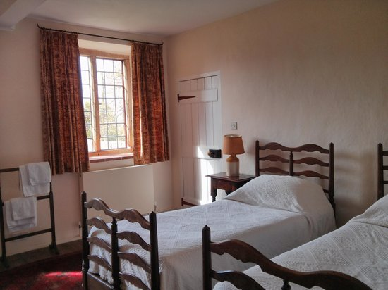 Woodspring Priory : 2nd twin room - adjoining to 2nd double bedroom; other door leads to stairs down to bathroom