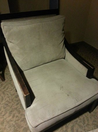 "Maplewood Suites Extended Stay: This was the chair that we moved into the ""deluxe"" room, which had no place to sit.  Gross."