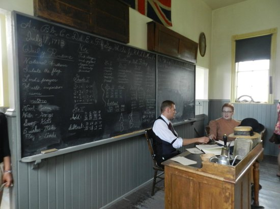 Heritage Park Historical Village: One of the school houses, teacher and helper