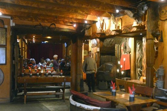 Viking Village Hotel: One of dining rooms having a medieval banquet in the rear.