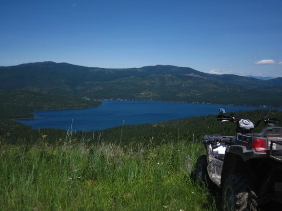 Proctor, MT: The lodge is the small white area at waters edge across the lake, surrounded by National Forest.