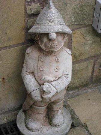 Primrose Cottage: Bob's figure at front door - he was a fireman!